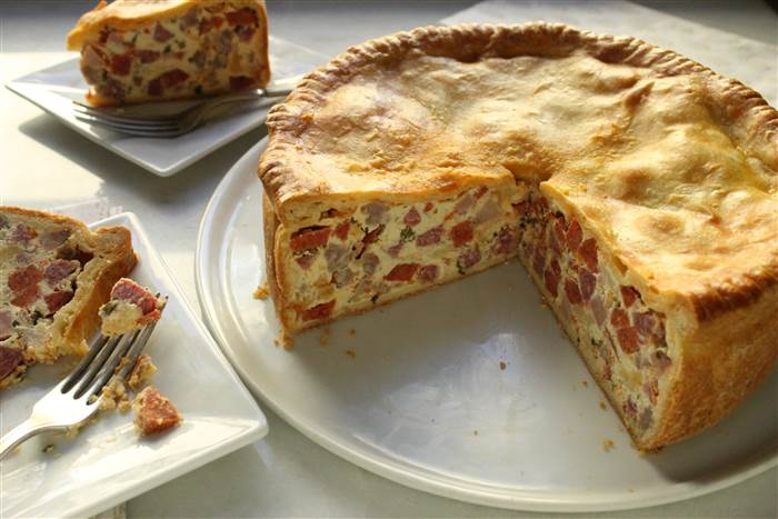 Learn about the Pizza Rustica, or Italian Easter Pie- a savory torte to celebrate the holiday!