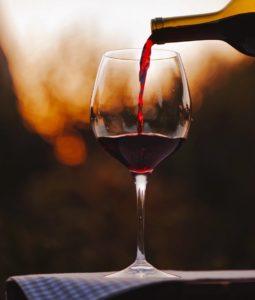 Italian wine pairings pouring merlot